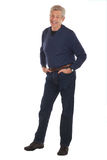Smiling senior man with hands in pockets Royalty Free Stock Photos