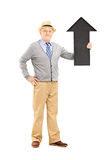 Smiling senior man holding a big black arrow pointing up Royalty Free Stock Photo