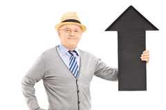Smiling senior man holding a big black arrow pointing up Royalty Free Stock Photos