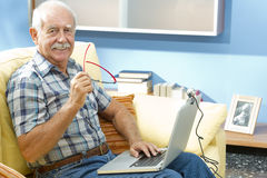 Smiling senior man at home Stock Photography