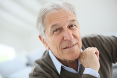 Smiling senior man at home Royalty Free Stock Photos