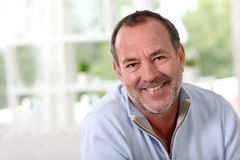 Smiling senior man at home Stock Photo