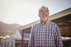 Smiling senior man looking at the sky. On a sunny day Stock Photo