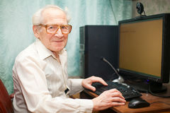 Smiling Senior Man Near Computer Stock Photography