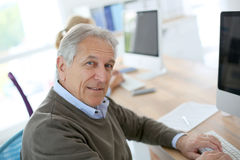 Smiling senior man at office Stock Images