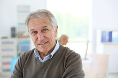 Smiling senior man at office Royalty Free Stock Images