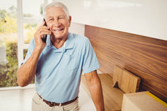 Smiling senior man on a phone call Stock Images