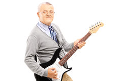 Smiling senior man playing guitar Royalty Free Stock Photo