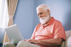 Aged man checking e-mails stock photo
