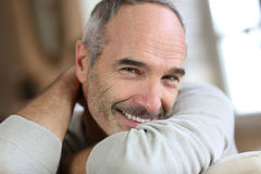 Smiling senior man relaxing at home Royalty Free Stock Photo
