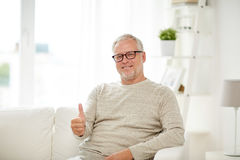 Smiling senior man showing thumbs up at home Royalty Free Stock Image