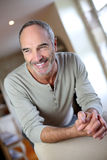 Smiling senior man sitting at home Royalty Free Stock Photo