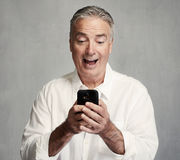 Smiling senior man with smartphone royalty free stock photos
