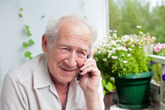 Pleased Senior Speaking On The Phone Royalty Free Stock Photos