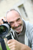 Smiling senior man taking pictures Royalty Free Stock Photography