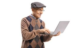 Smiling senior man using a laptop computer stock image