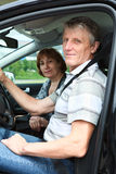 Smiling senior man and woman in car Stock Photos