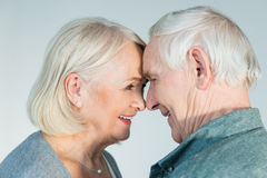 Smiling senior man and woman looking at each other stock photography