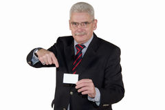 Smiling senior manager pointing at business card. A smiling senior caucasian manager pointing at a business card with copy space, isolated on white background Stock Photo