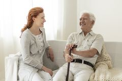 Smiling senior man having fun with happy daughter at home royalty free stock photo