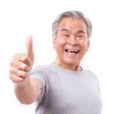 Smiling senior old man showing thumb up gesture Royalty Free Stock Photography