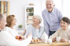 Smiling senior people enjoying meeting Royalty Free Stock Photos