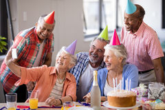 Smiling senior people taking selfie at party Royalty Free Stock Photography
