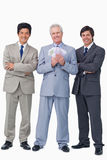 Smiling senior salesman with money and employees Royalty Free Stock Photo