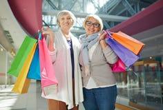 Smiling senior shoppers Stock Images
