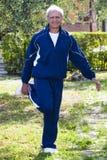 Smiling Senior Stretching Quadriceps Outdoor stock photography