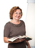 Smiling senior teacher. And white board royalty free stock image