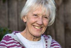 Smiling senior woman stock image