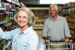 Smiling senior woman choosing food Stock Image