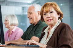 Smiling Senior Woman In Computer Class Royalty Free Stock Photo