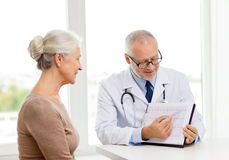 Smiling senior woman and doctor meeting Stock Image
