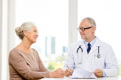 Smiling senior woman and doctor meeting Royalty Free Stock Image
