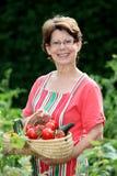 Smiling senior woman in garden Stock Image