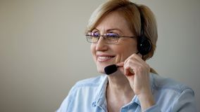 Smiling senior woman with headset dating online, love in old age, romantic. Stock photo royalty free stock image