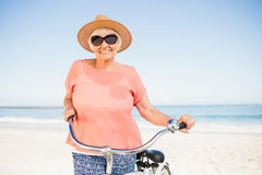 Smiling senior woman with her bike Stock Image