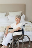 Smiling senior woman in her wheelchair Royalty Free Stock Images