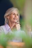 Smiling senior woman holding coffee mug Royalty Free Stock Photos