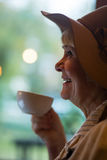 Smiling senior woman holding cup. Stock Image
