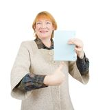 Smiling senior woman holding empty blue poster Stock Images
