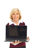 Smiling senior woman holding open laptop Royalty Free Stock Photography