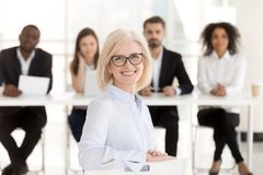 Smiling senior woman job applicant looking at camera during inte royalty free stock photography