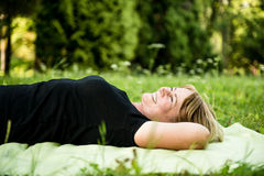 Smiling senior woman lying outdoor Stock Photos
