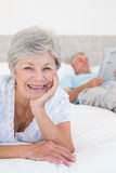 Smiling senior woman with man in bed Royalty Free Stock Photography
