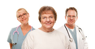 Smiling Senior Woman with Medical Doctor and Nurse Royalty Free Stock Images
