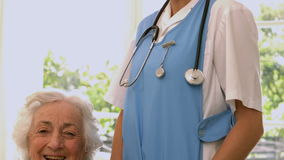 Smiling senior woman with nurse stock video