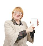 Smiling senior woman pointing on empty notebook Royalty Free Stock Images